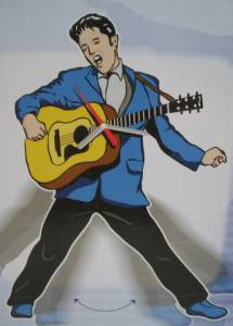 Rock and Roll Collectibles - Elvis Presley Swinging Hips Pendulum Clock